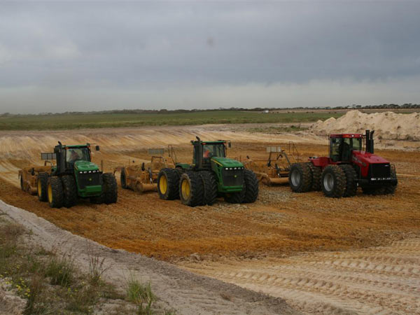 Three 4WD Tractor and Landplanes excavating clay